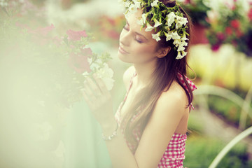 Charming girl with the flower hat