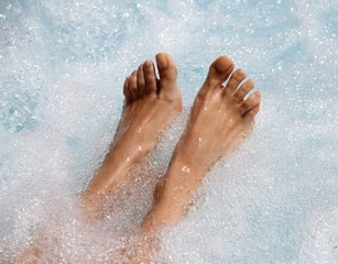 beautiful women's feet in the jacuzzi to facilitate venous circu