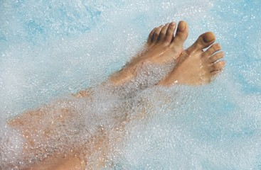 Women's feet in the jacuzzi to venous circulation
