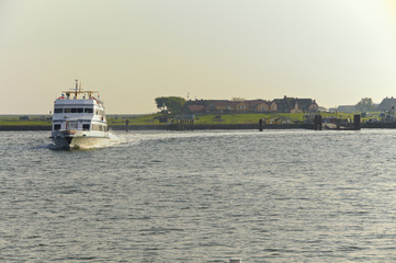 Passenger Ship in the Wadden Sea in the North Sea