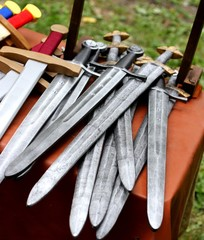 swords for sale at the market of medieval relics