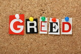 The word Greed on a cork notice board poster