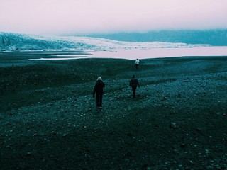 Hikers walking towards the Skaftafell glacier in Iceland