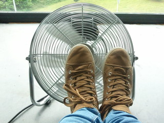 Feet on a fan. Hot day