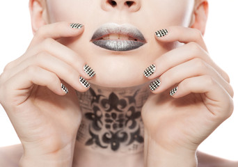 Beautiful woman with bright black lips and manicure