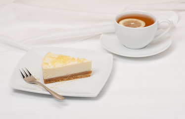 Cheese Cake With Lemon Zest. Tea With Lemon Slice