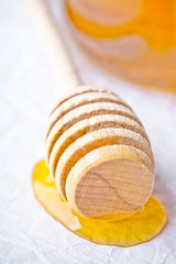 honey on wooden honey dipper