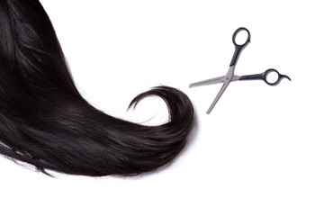Long black shiny hair with professional scissors