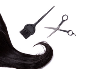 Long black shiny hair with professional scissors and hair dye br