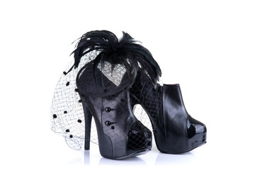 Black high heel female shoes and feather hair fascinator