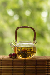 Transparent teapot with blooming tea flower