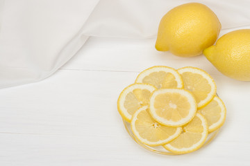 Lemons And Fresh Lemon Slices On A Plate