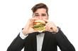 canvas print picture - junger Geschäftsmann isst  großen Burger