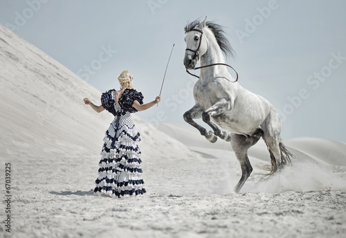 Attractive blonde training the horse