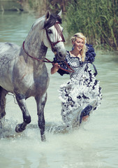 Blonde running with the horse
