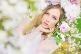 Delicate blonde in the summer garden