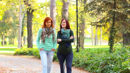 Two women, having a walk in the park