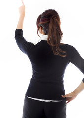 Rear view of a businesswoman pretending to working on virtual