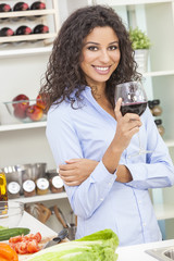 Woman Drinking Red Wine in Home Kitchen