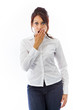 Shocked Indian young woman covering her mouth isolated on white