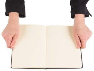 Hands holding an open book