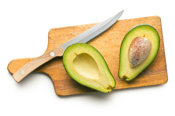 halved avocados on cutting board