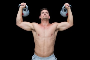 Strong bodybuilder lifting up kettlebells