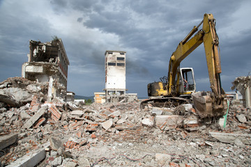 Bulldozer removes the debris from demolition of old buildings
