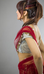 Side profile of an Indian young woman day dreaming