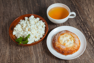 Plate with cottage cheese and a bun
