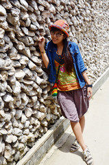 Thai women portrait with Oyster Shell wall in Wat Chedi Hoi