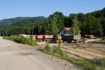 Trucks Parked by Construction Site