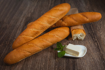 Baguettes on thr wooden table