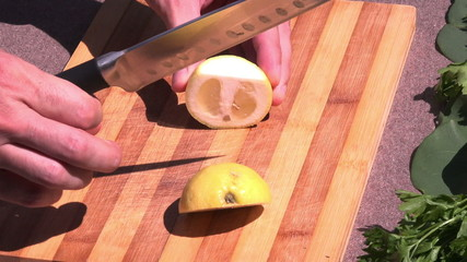 slicing lemon outside,close up
