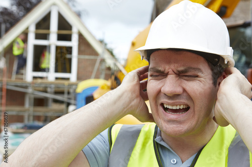 Construction Suffering From Noise Pollution On Building Site - 67050839