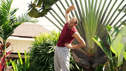 Young man exercising in the garden
