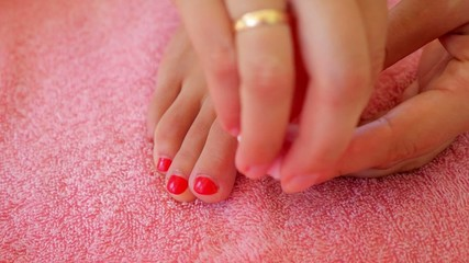 Close-up of Woman Removing Nail Polish from Her Legs. Before