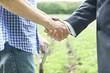 Leinwanddruck Bild - Farmer And Businessman Shaking Hands