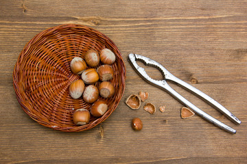 Hazelnuts on wooden nutcracker
