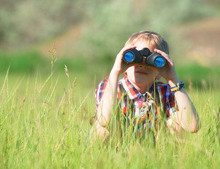 Boy looking through the binoculars