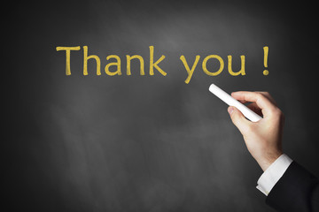 hand writing thank you on chalkboard