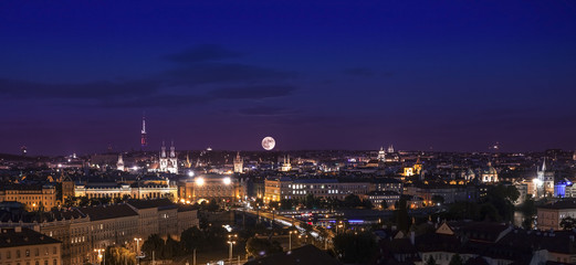 Full moon over city, Prague at night, Czech republic.