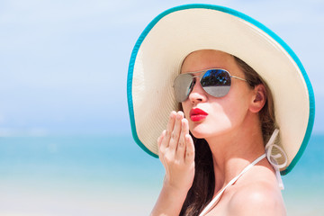 beautiful woman with red lips in sun hat.