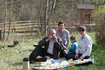 Family resting on picnic