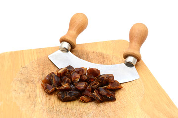 Chopped dates with a rocking knife