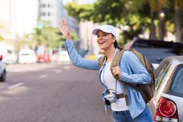 female tourist hailing for a cab
