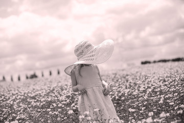 Young child in a flower field, black and white image