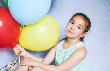 cute girl with colorful balloons