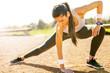 Zdjęcia na płótnie, fototapety, obrazy : Beutiful young woman stretching and preparing to run.