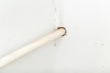 pipe in white wall
